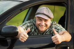 Driver shows that everything is fine. Happy driver shows that everything is fine Royalty Free Stock Image