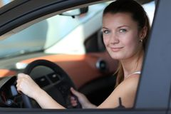 Driver. Smiling young female driver Royalty Free Stock Image