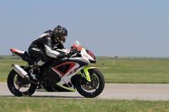 Driver solo della motocicletta sulla pista Immagine Stock