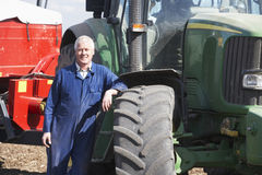 Driver Standing In Front Of Tractor Stock Photo