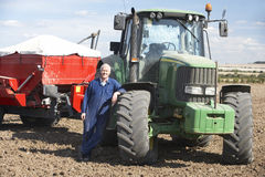Driver Standing In Front Of Tractor Stock Photography