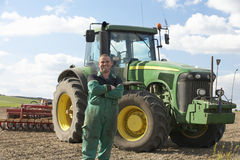 Driver Standing In Front Of Tractor Stock Photos