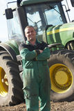 Driver Standing In Front Of Tractor royalty free stock photo