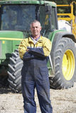 Driver Standing In Front Of Tractor Stock Images