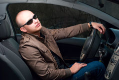 Driver in sunglasses Stock Images