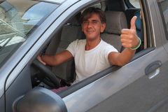 Driver with thumb up Royalty Free Stock Image