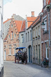 Driver to carry tourists down the street , Bruges Royalty Free Stock Photos