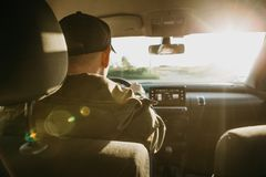 The driver or traveler or tourist is driving a car. Everyday riding or traveling Stock Photography