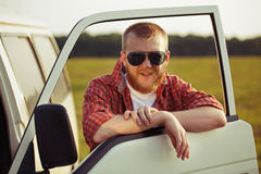 Driver of a truck in sunglasses. Bearded driver of a truck in sunglasses Royalty Free Stock Photo