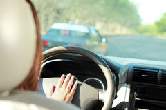 Driver use horn to warn car in front of her Royalty Free Stock Photography