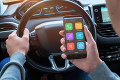 Driver use smart phone to find the required location information. Modern car interior with board navigation display Stock Photo