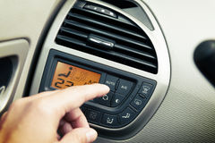 Driver using ac air-condition system. And pushing button car screen interface Royalty Free Stock Image