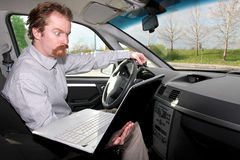 Driver using gps laptop Stock Photo