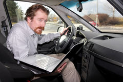 Driver using gps laptop Stock Image