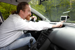 Driver using  GPS navigation Royalty Free Stock Images