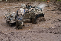 Driver and vehicle in mud Stock Photo