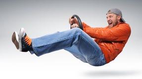 Driver veloce dell'uomo con una rotella fotografia stock libera da diritti