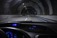 Driver view inside a car driving on a tunnel highway stock images