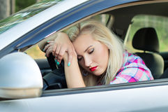 Driver was tired and fell asleep at the wheel of a car Stock Images