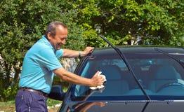 Driver washing a car Royalty Free Stock Image
