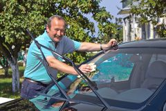Driver washing a car Royalty Free Stock Images