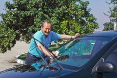 Driver washing a car Royalty Free Stock Photos