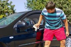 Driver washing a car Stock Photography