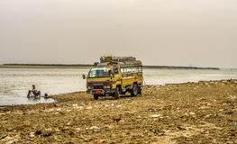 Driver washing his car in the Irrawaddy River Stock Images