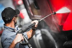 Driver Washing His Semi Truck. Truck Driver Washing His Semi Truck Tractor. Trucking Theme stock images