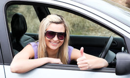 Driver wearing sunglasses with thumb up Stock Photography