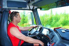 The driver at the wheel. Of the truck Royalty Free Stock Photography