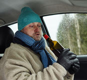 Driver and wine bottle Royalty Free Stock Photography