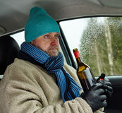 Driver and wine bottle Stock Photo