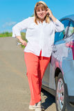Driver woman and a broken car. On the road Royalty Free Stock Photo