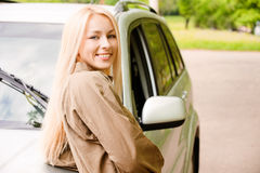 Driver-woman of car smiles Royalty Free Stock Photo