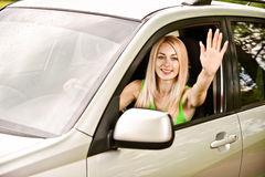 Driver-woman of car waves hand Royalty Free Stock Photography