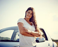 Driver Woman in front of her car Royalty Free Stock Image