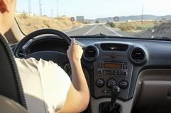 Driver woman getting close to overtaking forbidden road section royalty free stock photo