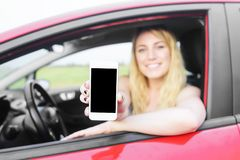 Driver woman showing her smartphone. Stock Images