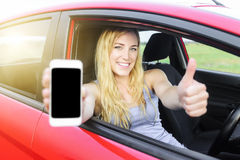Driver woman showing her smartphone. Royalty Free Stock Photo