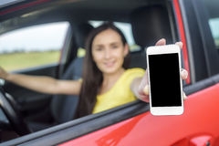 Driver woman showing her smartphone. Stock Photos