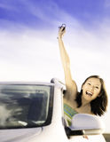 Driver woman showing new car keys. Woman holding car keys driving her new car royalty free stock images