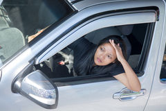 Driver woman watch from car Royalty Free Stock Photo
