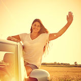 Driver woman waving Royalty Free Stock Images