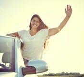 Driver woman waving Stock Photo