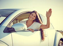 Driver woman waving Royalty Free Stock Photo