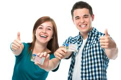Drivers license. Happy teens showing their driving license Stock Image