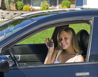 Drivers permit. Young teenager girl learning how to drive stock photo