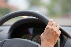 Drivers's hands on a stearing wheel Stock Image