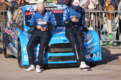 Drivers are sitting on the hood of the Ford Fiesta RS WRC2 - Mon Stock Photography